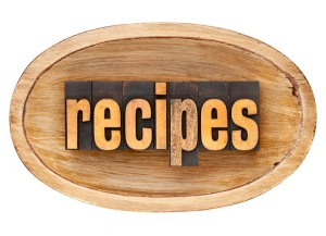recipes - word in vintage letterpress wood type inside rustic wooden dough bowl, isolated on white