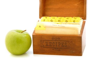 Recipe box with apple. Apple fritter recipe card showing.